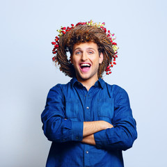 Portrait of a laughing funny man with wreath