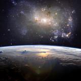 A beautiful nebula (irregular galaxy, NGC 4449) over the Earth