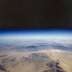 The desert in the western United States. Stars above.