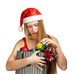 Young woman in santa hat with christmas attributes and little gi