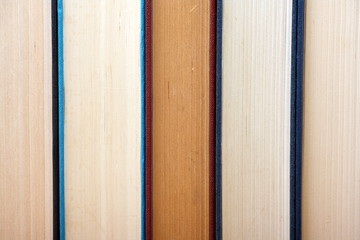 Old hardback books in a row form a background image
