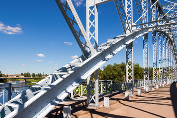 Detail of steel arch bridge across river Msta. Novgorod region,