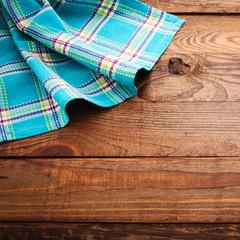 Wood texture on checkered tablecloth tartan.
