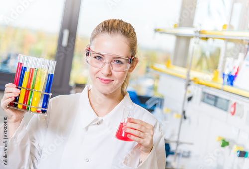 canvas print picture young woman in a chemical lab