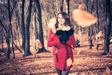 woman portrait through falling leafs