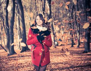 pretty brunet portrait in falling leafs