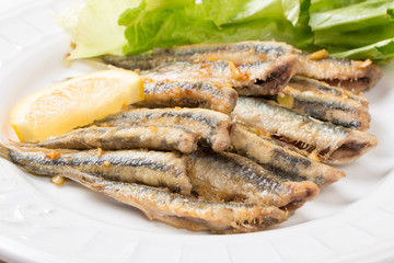 Fried anchovies with salad