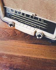 Retro Radio on wooden table background