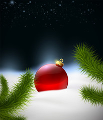 Christmas background with Christmas ball in the snow