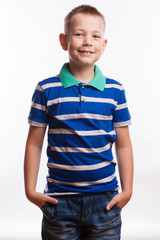 Young pretty boy posing at studio as a fashion model.