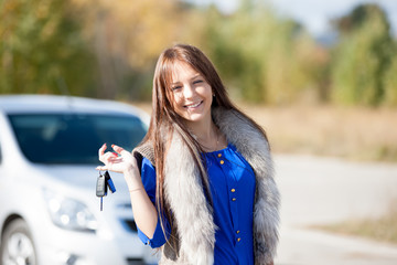 girl in a car holding keys