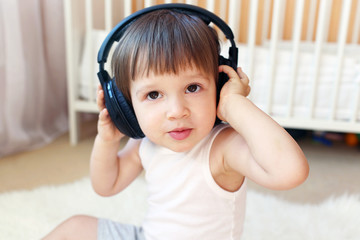 toddler listening to music with headphones