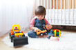 2 years toddler boy plays cars at home