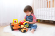 little boy plays cars at home