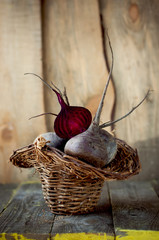 Fresh beets in a basket on wooden boards