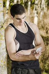 Sportsman runner man looking his statistics on smart phone