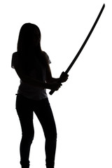 Silhouette of young woman with sword