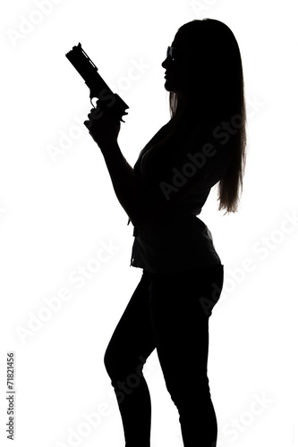 Poster Silhouette of young sexy woman with gun