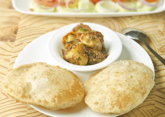 Yummy puri with potato dum curry