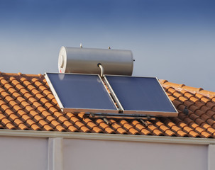 Solar water heater on roof of house