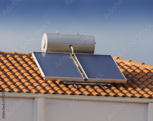 Solar water heater on roof of house - 71822459