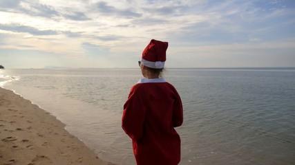 Christmas Holiday Vacation at Beach. Santa in Bikini. Slow