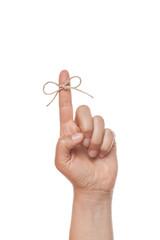 bow on finger, isolated on white background
