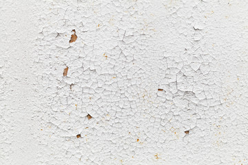 Rusted white metal wall with cracks, background texture
