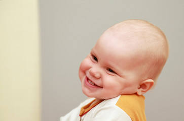 Closeup portrait of funny smiling Caucasian baby