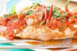 poisson entier (sacré chien) cuisiné à la sauce créole