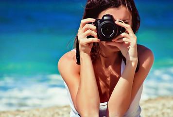 woman photographer on the beach