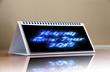 Happy New Year 2015 celebration concept, calendar on wooden tabl