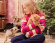 girl with pets on background christmas tree