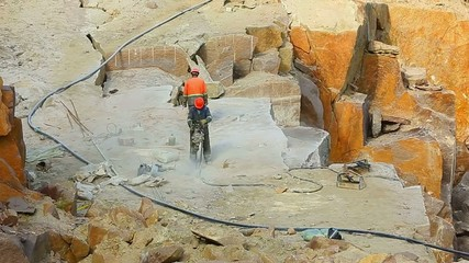 worker works in a granite pit