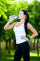 Portrait Of Young Woman Drinking Water After Jogging