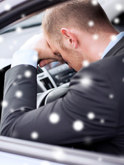 close up of businessman driving car