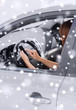 close up of woman with smartphone driving car