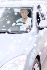 man driving car and putting parking clock