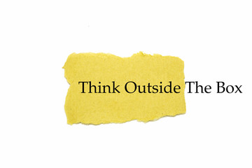 Think outside the box text on brown paper