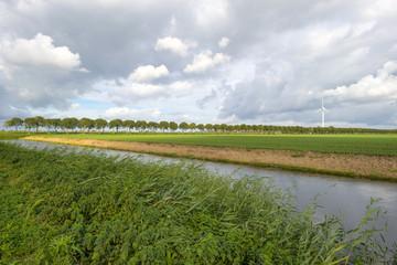 Canal through a rural landscape at fall