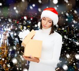 woman in santa helper hat with gift box