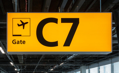 Illuminated sign at airport with gate number