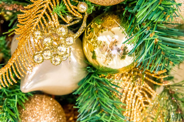 Christmas decorations, gold ornaments and feather