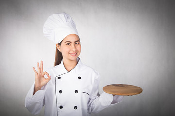 Woman chef showing and presenting