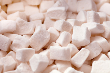 Tender white marshmallow pieces background