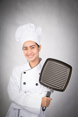 Woman chef holding pan