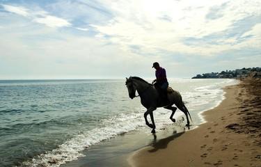Jinete por la playa