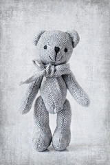 teddy bear on an old style background