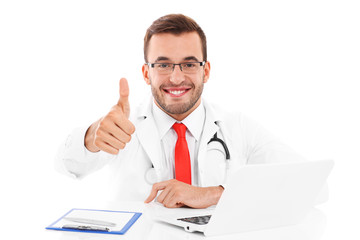 Doctor with laptop and documents showing ok sign