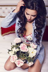 beautiful woman with dark hair holding a bouquet of flowers